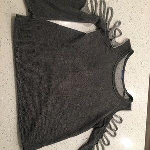 Cut out grey sweatshirt.